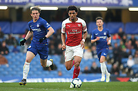 Xavier Amaechi of Arsenal in possession as Chelsea's Conor Gallagher looks on during Chelsea Under-23 vs Arsenal Under-23, Premier League 2 Football at Stamford Bridge on 15th April 2019
