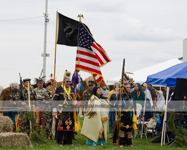 "Native Americans at the Healing Horse Spirit PowWow in Mt. Airy, Maryland carry an American flag POW-MIA flag.  They standy ready for the ""Grand Entrance.""  Many Native Americans are U.S. soldiers or veterans."
