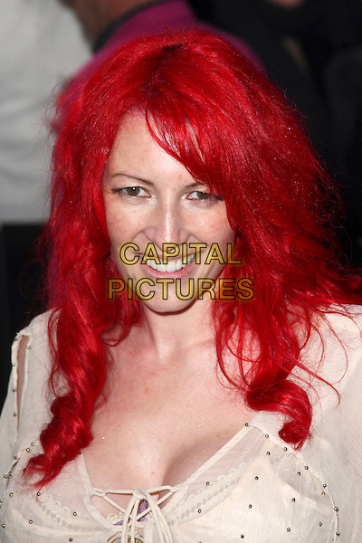 JANE GOLDMAN .British Comedy Awards 2009 held at the ITV Studios, South Bank, London,.December 12th 2009..portrait headshot dyed red hair beige cream smiling gold bobbles beads beaded .CAP/JIL.©Jill Mayhew/Capital Pictures