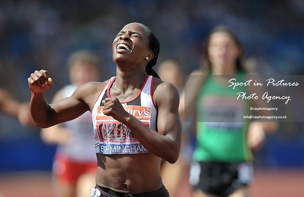 Marilyn OKORO (SHAFT'BURY) celebrates winning the womens 800m. Sainsburys British Championships. Diamond League. Alexander Stadium. Birmingham. UK. 13/07/2013. MANDATORY Credit Garry Bowden/SIPPA - NO UNAUTHORISED USE - 07837 394578