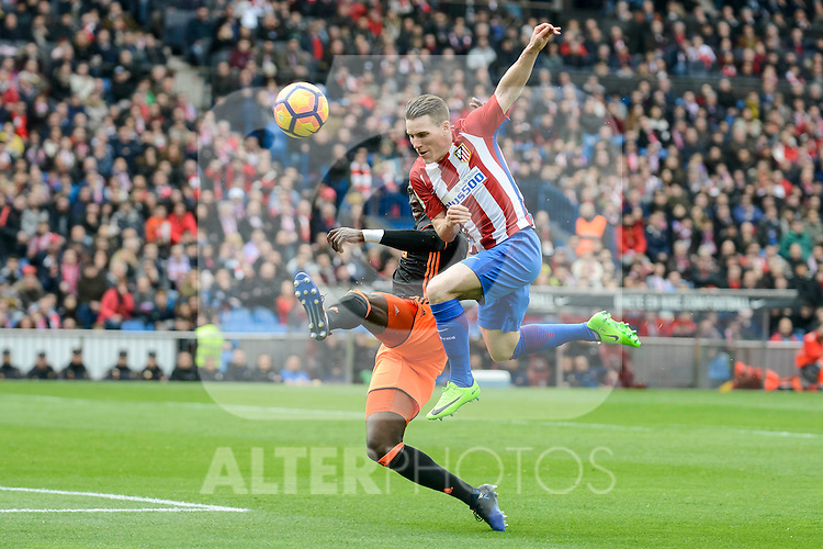 Atletico de Madrid's Kevin Gameiro and Valencia CF's Eliaquim Mangala during La Liga match between Atletico de Madrid and Valencia CF at Vicente Calderon Stadium  in Madrid, Spain. March 05, 2017. (ALTERPHOTOS/BorjaB.Hojas)