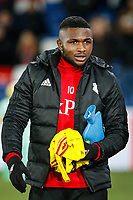 Substitute Isaac Success of Watford holds onto his hot water bottle ahead of the Premier League match between Crystal Palace and Watford at Selhurst Park, London, England on 12 December 2017. Photo by Carlton Myrie / PRiME Media Images.
