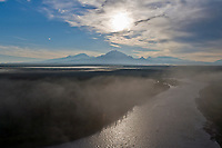 Mount Sanford, mount Drum and mount wrangell of the Wrangell Mountains, Wrangell St. Elias National Park, Alaska. morning fog on the copper river.