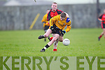 Listowel Emmets Connor Cox(12) feels the pressure from Jasen Wren(7) of Tarbert in the North Kerry Senior Football Final held last Sunday in Bob Stack Park, Ballybunion.