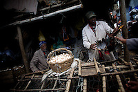 shop keepers selling live chickens to be slaughtered the next day at the Shola Market  on the last day of the year 2000 marked on the Gregorian Calender followed in Ethiopia. The image was taken on Wednesday September 10 2008 in Ethiopia's capital Addis Ababa..the Gregorian Calender marks 13 months starting on September 11 of the western calendar. In the year 2007 Ethiopians celebrated their Millennium. Currently the country struggles with two digit inflation, food commodities more than doubled in price in the last year and millions of Ethiopians depending on food aid.