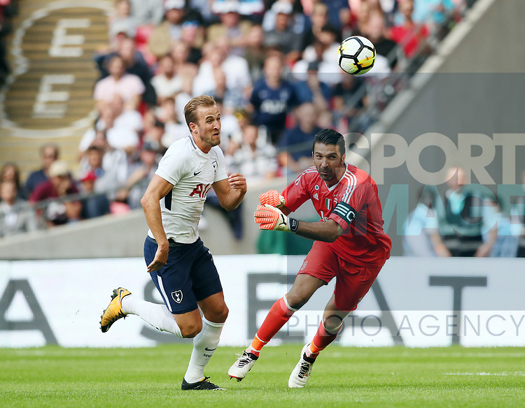 Tottenham's Harry Kane tussles with Juventus Gianluigi Buffon during the pre season match at Wembley Stadium, London. Picture date 5th August 2017. Picture credit should read: David Klein/Sportimage