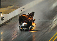 Jul. 16, 2010; Sonoma, CA, USA; NHRA funny car driver Gary Densham explodes an engine during qualifying for the Fram Autolite Nationals at Infineon Raceway. Mandatory Credit: Mark J. Rebilas-