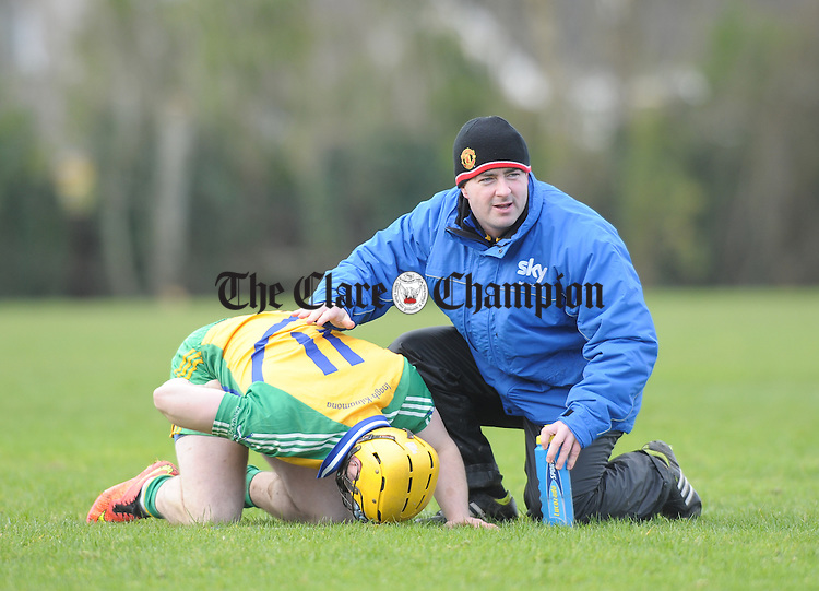 Jason Mc Carthy of Inagh-Kilnamona goes down with an injury againstf Kilmaley during their U-21A first round game in Meelick. Photograph by John Kelly.