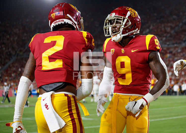 LOS ANGELES, CA - SEPTEMBER 8: USC Trojans cornerback Olaijah Griffin #2 is congratulated by Greg Johnson #9 for breaking up an end zone pass during a game between USC and Stanford Football at Los Angeles Memorial Coliseum on September 7, 2019 in Los Angeles, California.