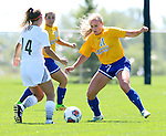 BROOKINGS, SD - AUGUST  22: Taylor Howe #14 from Green Bay looks to move the ball around the defense of Nicole Hatcher #11 from South Dakota State University in the first half of their game Sunday afternoon at Fischback Soccer Field in Brookings. (Photo by Dave Eggen/Inertia)