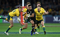 Richie Mo'unga of the All Blacks breaks away from Reece Hodge and Nic White of the Wallabies during the Rugby Championship match between Australia and New Zealand at Optus Stadium in Perth, Australia on August 10, 2019 . Photo: Gary Day / Frozen In Motion