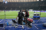A television crew struggling with their equipment prior to the live broadcast of the game between Hertha Berlin and Sporting Lisbon in the Olympic Stadium in Berlin in a UEFA Europa League group match. Hertha won the match by 1 goal to nil to press to the knock-out round of the cup. 2009/10 was the the first year in which the Europa League replaced the UEFA Cup in European football competition.