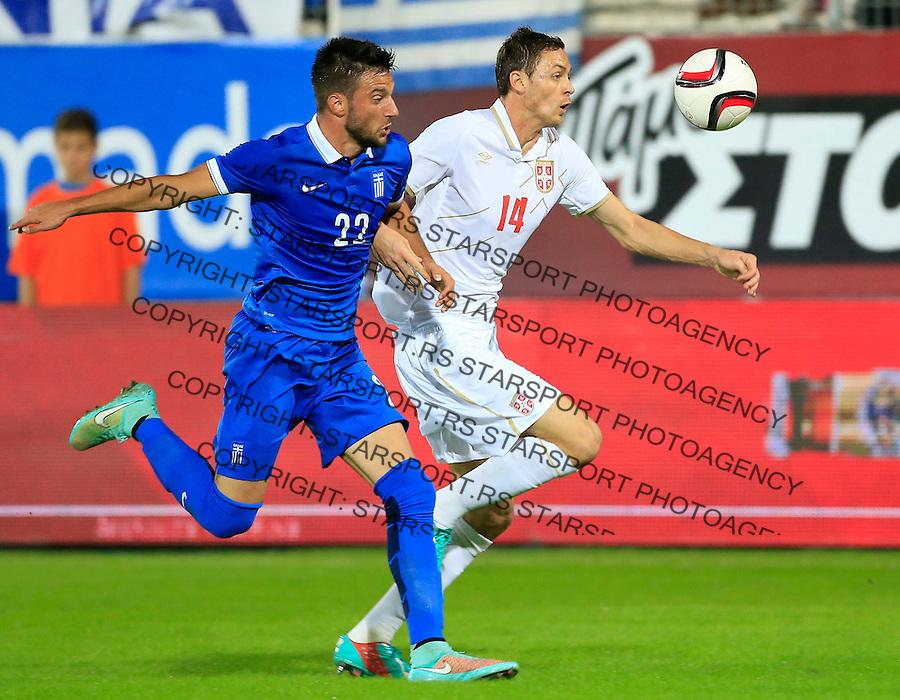 Fudbal<br /> Prijateljski mec-Friendly match<br /> Srbija v Grcka<br /> Nemanja Matic (R) and Andreas Samaris<br /> Chania, 18.11.2014.<br /> foto: Srdjan Stevanovic/Starsportphoto &copy;