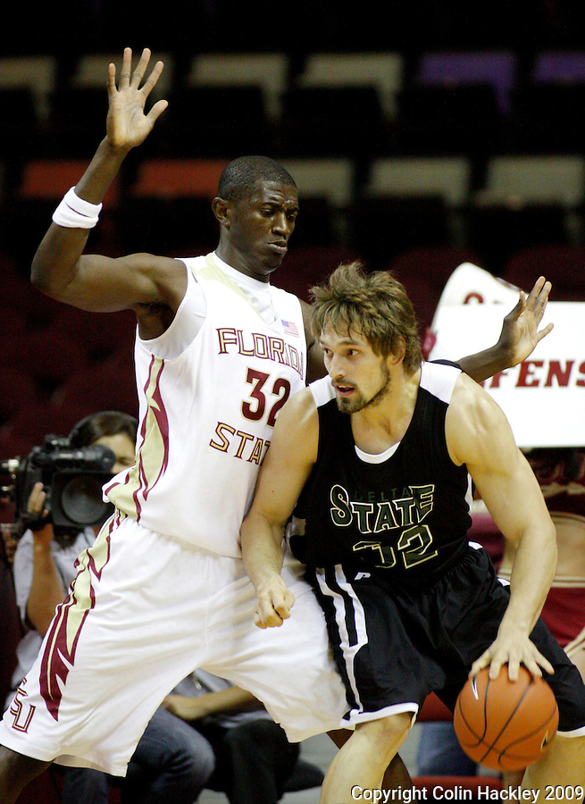 TALLAHASSEE, FL 11/3/09-FSU-DELTA BB09 CH05-Florida State's Solomon Alabi, left, guards Delta State's Dmitry Pirshin during first half action Tuesday at the Tallahassee-Leon County Civic Center. The Seminoles beat the Statesmen 81-38 in their first exhibition game of the season...COLIN HACKLEY PHOTO