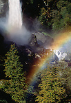 Rainbow over the waterfall Foroglio, Ticino, Switzerland, deciduous trees