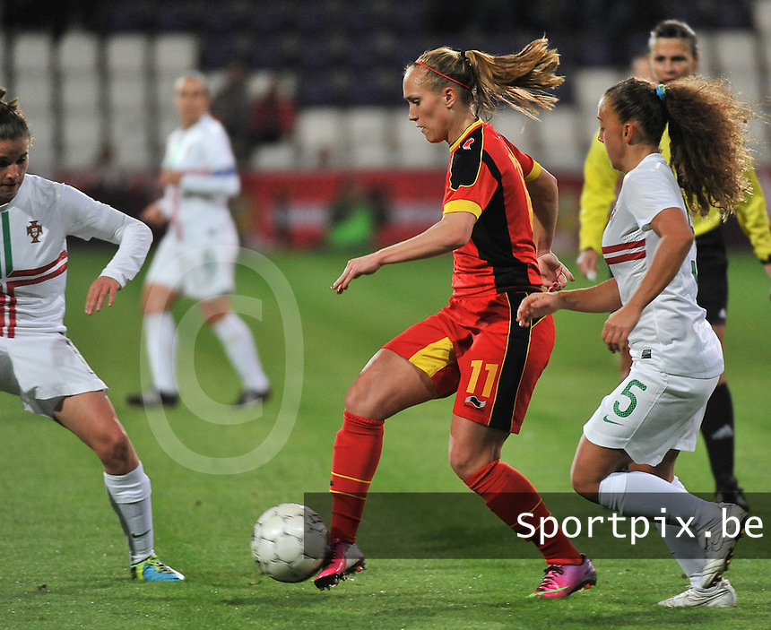 20131031 - ANTWERPEN , BELGIUM : Belgian Janice Cayman (11) pictured with the Portugese Matilde Fidalgo (5) in her back  during the female soccer match between Belgium and Portugal , on the fourth matchday in group 5 of the UEFA qualifying round to the FIFA Women World Cup in Canada 2015 at Het Kiel stadium , Antwerp . Thursday 31st October 2013. PHOTO DAVID CATRY