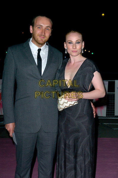 ROSIE MARCEL & GUEST.V & A Golden Age of Couture Gala Victoria and Albert Museum, London, England. .September 18th, 2007 .half 3/4 clutch purse length black dress sleeveless grey grey suit holby city.CAP/CAN.©Can Nguyen/Capital Pictures
