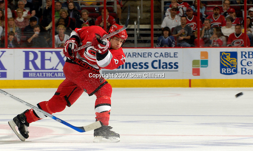 Carolina Hurricanes' Tim Gleason takes a shot during a game with the Washington Capitals Thursday, March 22, 2007 at the RBC Center in Raleigh, NC. Carolina won 4-3.
