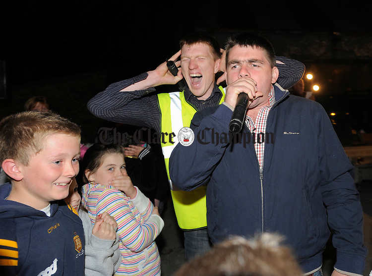 Last year's champion Jpoe O Gorman shows how its done as Mc Niall Gilligan feels the decibels at the Clare Shout Festival competition in KIilkishen. Photograph by John Kelly.