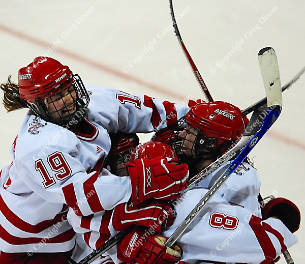 "6'1"" Badger junior Jinelle Zaugg scores the winning goal in the 4th overtime at the Kohl Center as Wisconsin tops Harvard 1-0 Saturday night"