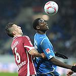 11.12.2010, Rhein-Neckar-Arena, Sinsheim, GER, 1.FBL, TSG Hoffenheim vs 1.FC Nuernberg, im Bild Dominic Maroh (Nuernberg #6) im Zweikampf mit Mlapa Peniel (Hoffenheim GER #15)m Foto © nph / Roth