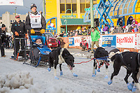Thomas Waerner and team leave the ceremonial start line with an Iditarider at 4th Avenue and D street in downtown Anchorage, Alaska during the 2015 Iditarod race. Photo by Jim Kohl/IditarodPhotos.com