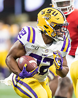 ATLANTA, GA - DECEMBER 7: Clyde Edwards-Helaire #22 of the LSU Tigers runs with the ball during a game between Georgia Bulldogs and LSU Tigers at Mercedes Benz Stadium on December 7, 2019 in Atlanta, Georgia.