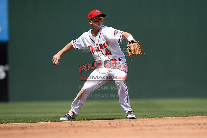 Shortstop Grant Williams (4) of the Greenville Drive picks up a ground ball and throws out a runner in a game against the Hickory Crawdads on Tuesday, April 30, 2019, at Fluor Field at the West End in Greenville, South Carolina. Hickory won, 5-4. (Tom Priddy/Four Seam Images)