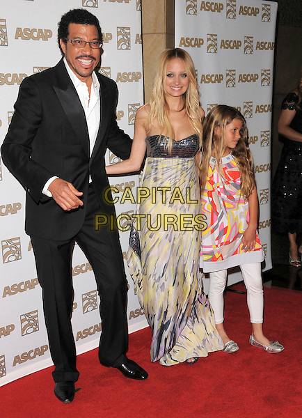 LIONEL RICHIE, NICOLE RICHIE & SOPHIE RICHIE.at The 2008 ASCAP Pop Awards held at The Kodak Theatre in Hollywood, California, USA, April 09 2008                                                                   .full length sister glasses father daughter family dad beard moustache black suit grey gray yellow sequined strapless dress print patterned bag .CAP/DVS.©Debbie VanStory/Capital Picturestie