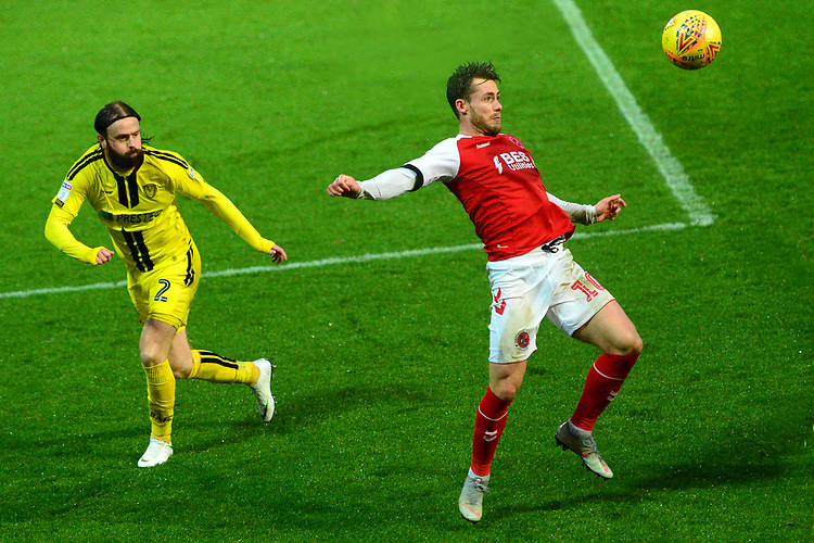 Fleetwood Town's Lewis Coyle competes with Burton Albion's John Brayford<br /> <br /> Photographer Richard Martin-Roberts/CameraSport<br /> <br /> The EFL Sky Bet League One - Saturday 15th December 2018 - Fleetwood Town v Burton Albion - Highbury Stadium - Fleetwood<br /> <br /> World Copyright © 2018 CameraSport. All rights reserved. 43 Linden Ave. Countesthorpe. Leicester. England. LE8 5PG - Tel: +44 (0) 116 277 4147 - admin@camerasport.com - www.camerasport.com