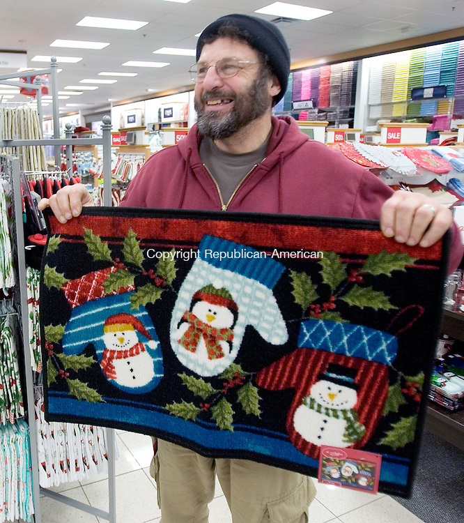 WATERBURY CT. 28 November 2014-112514SV12-Philip Ricci of Bristol found a holiday doormat he liked while shopping at Kohls in Waterbury Friday.   <br /> Steven Valenti Republican-American