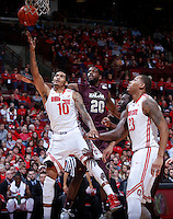 Ohio State Buckeyes forward LaQuinton Ross (10) is guarded by Louisiana-Monroe Warhawks forward Evan Sims (20) during Friday's NCAA Division I basketball game at Value City Arena in Columbus on December 27, 2013. Ohio State won the game 71-31. (Barbara J. Perenic/The Columbus Dispatch)