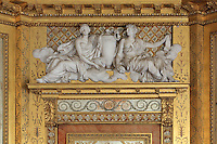 Overdoors with high reliefs in plaster depicting 8 of the 9 muses by Roland, in the Boudoir de la Reine or Silver Bedroom, designed by the architect Pierre-Marie Rousseau, 1751-1829, used by Marie-Antoinette in the Queen's Apartments, Chateau de Fontainebleau, France. The Palace of Fontainebleau is one of the largest French royal palaces and was begun in the early 16th century for Francois I. It was listed as a UNESCO World Heritage Site in 1981. Picture by Manuel Cohen