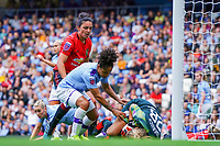 20190907 – MANCHESTER, ENGLAND: Manchester City's goal keeper Ellie Roebuck is pictured catching the ball and Demi Stokes pictured protecting the goal keeper by blocking Manchester United'sJess Sigsworth  during the match between Manchester City Women and Manchester United Women, first game for both of the teams in the Barclays FA Women's Super League , Saturday  7th September 2019 at the Ethiad Stadium, Manchester. PHOTO SPORTPIX.BE | Sevil Oktem