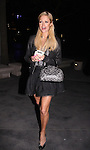 3-29-2010..Paris Hilton laughing while leaving the Black Eyed Peas concert at the Staples Center in Los Angeles California. Paris was sporting some really big eye lashes ...AbilityFilms@yahoo.com.805-427-3519.www.AbilityFilms.com
