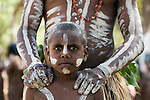 Indigenous boy and father at the Laura Aboriginal Dance Festival.  Laura, Queensland, Australia
