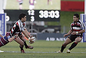 Male Sa'u looks to pass to Niva Ta'auso during the Air NZ Cup game between the Counties Manukau Steelers and Southland played at Mt Smart Stadium on 3rd September 2006. Counties Manukau won 29 - 8.
