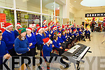 Kilflynn National School singing Christmas carols at Manor West retail park on Thursday.