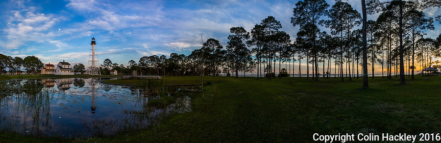 PORT ST. JOE, FLA. 4/19/16-As the sun sets the Cape San Blas Lighthouse and rising moon are reflected in the a pond of George Core Park in Port St. Joe, Fla. The light was moved to the park in 2014.<br /> <br /> EDITOR'S NOTE: This image is comprised of multiple photos taken at the same moment and stitched together in photoshop to create a panorama.<br /> <br /> COLIN HACKLEY PHOTO