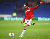 26th November 2019; Cardiff City Stadium, Cardiff, Glamorgan, Wales; English Championship Football, Cardiff City versus Stoke City; Joe Allen of Stoke City takes a shot during warm up - Strictly Editorial Use Only. No use with unauthorized audio, video, data, fixture lists, club/league logos or 'live' services. Online in-match use limited to 120 images, no video emulation. No use in betting, games or single club/league/player publications