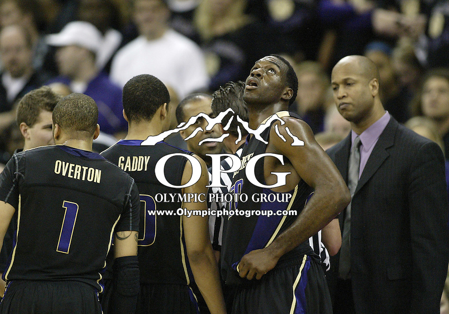 30 January 2010:  Washington Huskies forward #20 Quincy Pondexter looks up at the scoreboard during a timeout against Washington State. Washington won 92-64 over Washington State University at the Bank of America Arena in Seattle, WA.