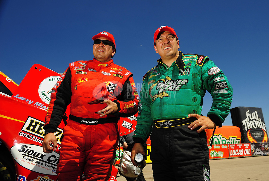 May 30, 2009; Topeka, KS, USA: NHRA funny car driver Cruz Pedregon (left) with brother Tony Pedregon during qualifying for the Summer Nationals at Heartland Park Topeka. Mandatory Credit: Mark J. Rebilas-