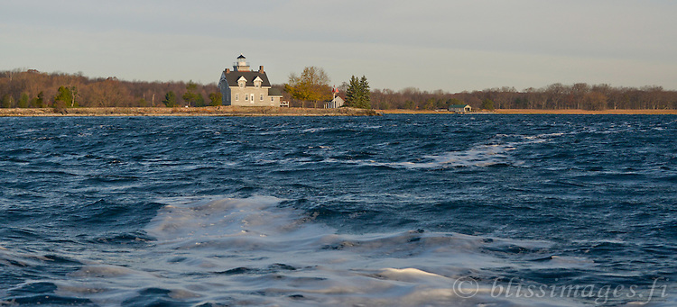 Windy water foam in the shipping channel at Sisters Island Lighthouse in the 1000 Islands of New York State.
