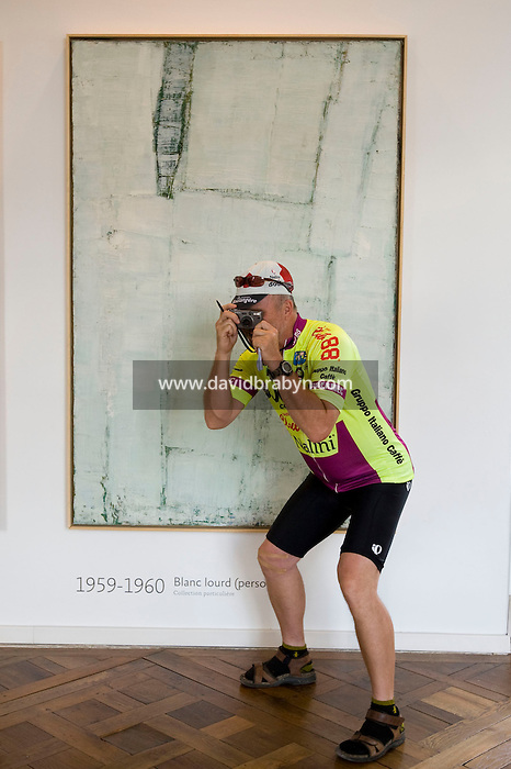 Writer David Darlington, participating in a Backroads cycle tour of the Loire Valley, takes a picture in a room of the Chenonceau castle displaying artwork by Olivier Debre in Chenonceaux, France, 25 June 2008.