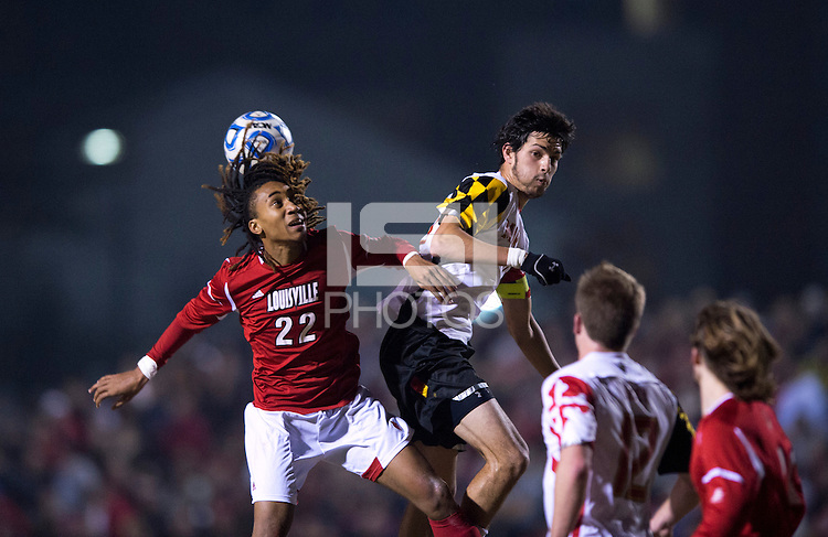 John Stertzer (27) of Maryland goes up for a header with Marlon Hairston (22) of Louisville during the game at Ludwig Field in College Park, MD.  Maryland defeated Louisville, 3-1.