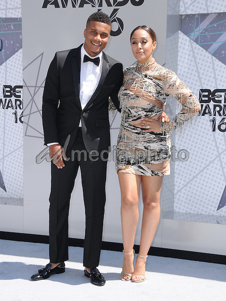 26 June 2016 - Los Angeles. Cory Hardrict, Tia Mowry-Hardrict. Arrivals for the 2016 BET Awards held at the Microsoft Theater. Photo Credit: Birdie Thompson/AdMedia