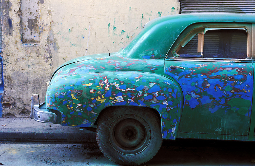 Cuba, Havana. Old car primed many times for a paint jo