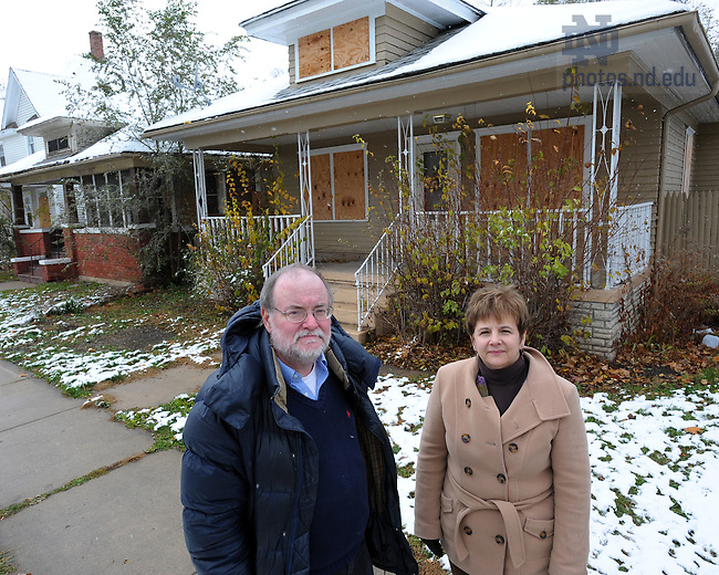 Richard Williams and Judy Fox outside a boarded up home in South Bend.  For Notre Dame Magazine..Photo by Matt Cashore/University of Notre Dame