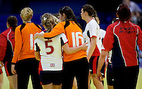 31 MAR 2010 - LONDON, GBR - Britains Nina Heglund (#5) and Laura Innes (#16) console each other after the teams 16-27 loss against Iceland in their 2010 European Womens Handball Championships qualifier (PHOTO (C) NIGEL FARROW)
