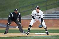 Wake Forest Demon Deacons first baseman Cole McNamee (40) on defense as umpire Gregory Street looks on during the game against the Florida State Seminoles at David F. Couch Ballpark on March 9, 2018 in  Winston-Salem, North Carolina.  The Seminoles defeated the Demon Deacons 7-3.  (Brian Westerholt/Four Seam Images)